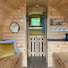 Inside the barrel pod - 1 double cabin bed and 2 single beds