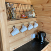 Pods have a kettle, toaster as well as fair-traded teabags and coffee so you can pop the kettle on when you arrive!