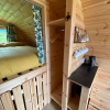 Storage shelves with hangers - there are lots of cleverly designed storage nooks in the pods. Up the back is a double bed with comfortable mattress and little curtain to separate the front and back of the pod.
