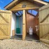 Private wash huts next to pods with instant hot water showers, eco compost toilet and cold water sink