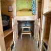 Under cabin where table and stool is stored, a good place to store bags or for the kids to have fun hiding in!