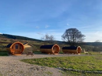 three glamping pods